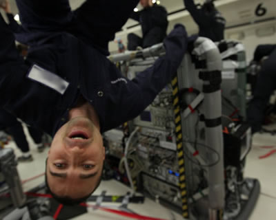 An Onera physicist upside down in the Airbus Zero-G in parabolic flight